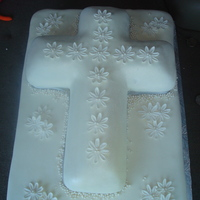 Cross Cake I had a woman order a cross cake but she wanted it for 60 people. AGHH! I used the Wilton cross pan and covered it in MMF. I also made a...