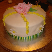 Course 4 Final Cake I covered the cake in white MMF. It has a real ribbon border and topped with a Wilton Fantasy Flower made of gumpaste. I also added...