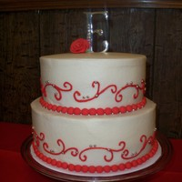 Simple Red Scroll Wedding Cake Simple round tiered wedding cake. It was accompanied by 300 cupcakes! Cake is red velvet w/ vanilla buttercream filling.