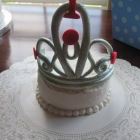 Gumpaste Tiara Gumpaste Tiara on a high chair cake
