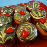 Black Gilded Cupcakes Made my hubby some cupcakes for Valentine's Day. Butternut squash spice cake with vanilla butter cream. Black fondant stamped with...