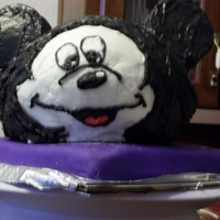 Mickey Mouse Made this cake for a Coworker. It is an all edible yellow cake with all buttercream icing, bottom cake covered in fondant. Had a little...