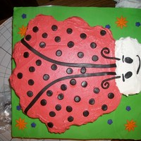Ladybug Cupcake Cake yellow cupcake with buttercream icing colored with cherry kool-aid and maraschino cherry juice.