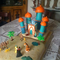 Aladdin's Castle  This was my second birthday cake, this time for a little girl. It was more elaborated than the Mario cake. The towers of the castle were...