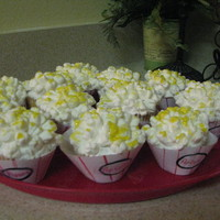 Popcorn Cupcakes Yellow cupcakes with bc icing and mini marshmallows cut with an x on top to look like popcorn using scissors. The butter topping effect was...