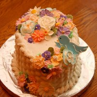 Flower Basket Covered in BC icing with Royal Icing flowers and bird