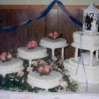Heart Shaped Wedding Cake With Fresh Pink Roses This is a cake I made for a friend's wedding. My 3rd wedding cake. Heart shaped tiered cake with four heart shaped satellites,...