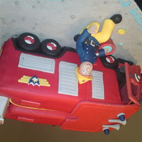 Fireman Sam Fireman Sam cake, I made this with an open cab front. All completely edible & handmade.