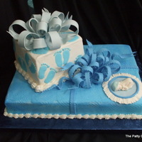 Baby Boy Shower stacked packages in buttercream, sugarpaste bow and baby.