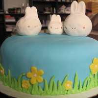 First Easter Cake This is my first easter cake. the top bunnies are made out of rice krispy treats and gum paste. I will never use gum paste again, but i was...