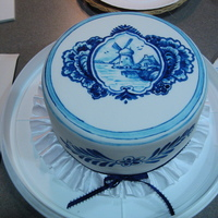 Blue Delft Cake This cake was for my husband's mother. She loves blue delft pottery so i hand painted a traditional design on white fondant. I got...