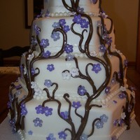 Lavender Cherry Blossom Cake   4 tier, fondant covered, white cake.