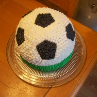 "Soccer Ball Cake My son wanted a soccer ball cake. I used a metal bowl for the ball part, the bottom is simply an 8"" round. I tried to make the bottom..."