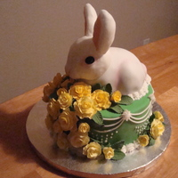 Wilton- Fondant Class 3 layer yellow cake covered in spring green fondant with a chocalate cake tier that was carved as a bunny. The bunny is covered in white...