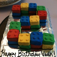Lego Cake Individual lego blocks iced and placed in the shape of a 2