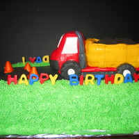 Dump Truck Cake Truck is rice krispie treats covered in fondant. Dirt is crushed oreos.