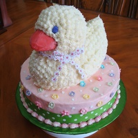 "3-D Duck Baby Shower Cake   Used 3-D duck pan on 10"" rnd. BC with fondant accent and real ribbon on the bottom."