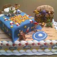 Toy Story Cake I made this for a friends 2yr old son birthday! The bed was cake covered in fondant. The toy chest was made with cereal treats and edible...