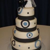 "Black And Country Blue   12"" choc. 10"" yellow, 8"" choc., 6"" yellow covered with BC and fondant"