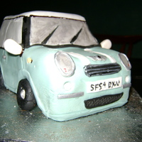 Mini Cooper I helped a friend make a mini cooper car for her dad's birthday.Made from Planet Cake's mudcake recipe, ganache then fondant....