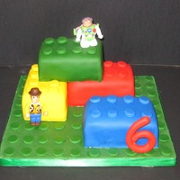 Lego Cake   This is made for my friends' son. He loves legos and wanted wood and buzz lego guys. The lego men are made from fondant.