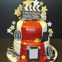 Hollywood Cake  This was made for a friends wedding shower the theme was hollywood themed had some trouble with the fondant I was using (homemade...