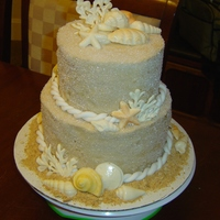 Seashell Wedding Cake  mini wedding cake. white chocolate shells covered in pearl luster dust. It is brown sugar buttercream with sugar cyrstals. I used graham...