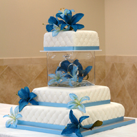 Square Wedding Cake With Glass Cube Separator And Blue Tiger Lillies