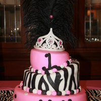 Diva Cake! Three tiers of fondant-covered goodness! The tiara is also fondant. Inedible boa feathers on top.