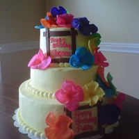 Luau Cake Yellow buttercream with fondant hibiscus flowers. Cake flavors were marbled orange vanilla with chocolate and pink vanilla with chocolate...