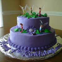 Tinkerbell Cake Majority buttercream with fondant embellishments and inedible figurines, at the customer's request.