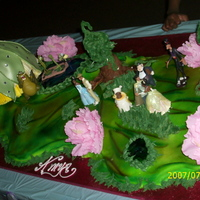 Princess And The Frog This cake was made for a special lil girl who turned 7, The cake is 5 Feet Long!!!!