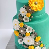 Teal With A Bright Yellow Flower! I made this cake for my mother and brother who celebrated their birthday last Saturday. They let me do whatever I wanted to do with the...
