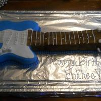 Electric Guitar  A blue electric guitar for a little Mongolian boys birthday.Chocolate Cake with buttercream frosting covered in fondant. Strings are......