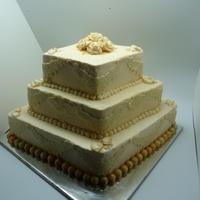 Gold And Lace Engagment Cake  i made this for my brothers engagment party.. bottom and top layers are vanilla with custard filling and middle layer is chocolate with...