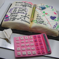 Graduation Math Text Book  a cake done by myself and my cousin for a friends graduation party. it took some time to do the calculator and the pencil but it went well...