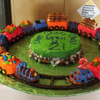 Choo Choo Choo Train Cake Train cake for my son's 2nd birthday. He's a train lover, and he LOVED this cake! Used Nordicware train cake pan for the engines...