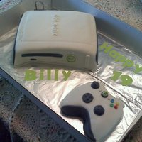 Xbox 360 Cake   Chocolate cake with bavarian cream filling covered in fondant with gumpaste details. Templates made from the actual xbox.