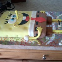 Sponge Bob Cake   Chocolate cake with a chocolate bavarian cream filling covered with fondant.