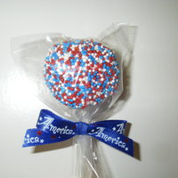 Cakepop! made these for memorial day. choco-choco-chip cake with chocolate buttercream frosting dipped in vanilla candies and twirled in red, white...