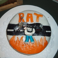 Harley/rat Cake This is another cake I made for my brother. His nickname is Rat. He has a tattoo of a rat wearing jeans, a tank top and a bandana with...