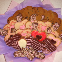 Valentine's Day Cookies V-Day cookies for my hubby. There's shortbread dipped in chocolate, shortbread sandwich cookies and chocolate pecan candy.