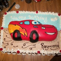 Cars Birthday Cake A whipped cream sheet cake. with a Fondant covered Lightning Mcqueen on top!! My frist time making a character cake. Free handed all of the...