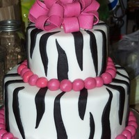Zebra Stripe Made this for a sweet 16 surprise party. This was my first time using ganache under fondant and let me say - LOVE IT!