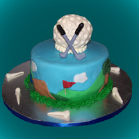 Golf Coconut cake with coconut buttercream. Golf ball, tees and clubs are made with modeling chocolate.
