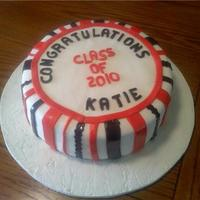 Congrats Graduation cake for a co-worker. This is a vanilla cake with lemon filling. Iced with buttercream then MMF.