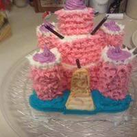 Pink Castle Cake  This is my first attempt at decorating a cake. The model was from an old cake book my grandmother had. The cake started to lean backwards...