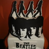 Beatles Gumpast characters on top with black and white sillouettes of the Beatles