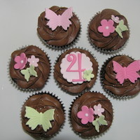 Butterflies And Blossoms   Chocolate cupcakes with chocolate buttercream.