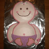 Baby Cake I made this for my friends baby shower. I used 2 round cake pans and I cut another round cake for the arms. The feet are cut from sugar...